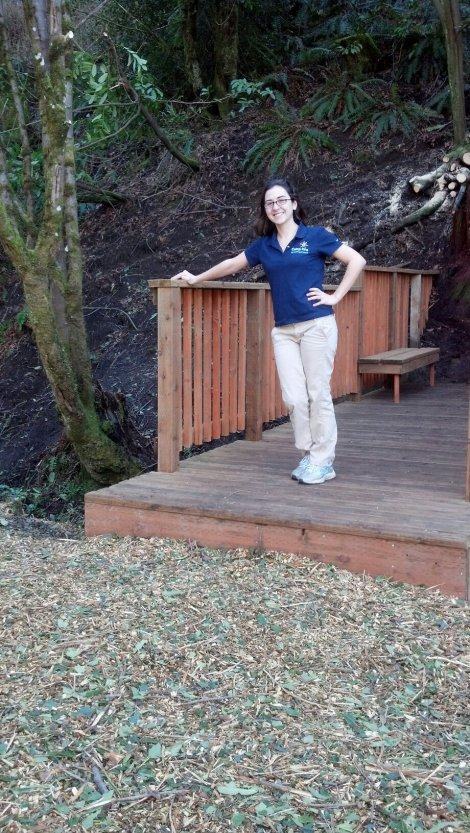 Lauren Dixon, Camp Sealth Environmental Education Assistant and Washington Service Corps AmeriCorps Member with the new bridge!